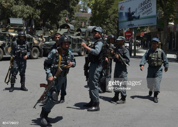 Afghan policemen arrive at the site of a suicide blast near Iraq's embassy in Kabul on July 31 2017 A series of explosions and the sound of gunfire...