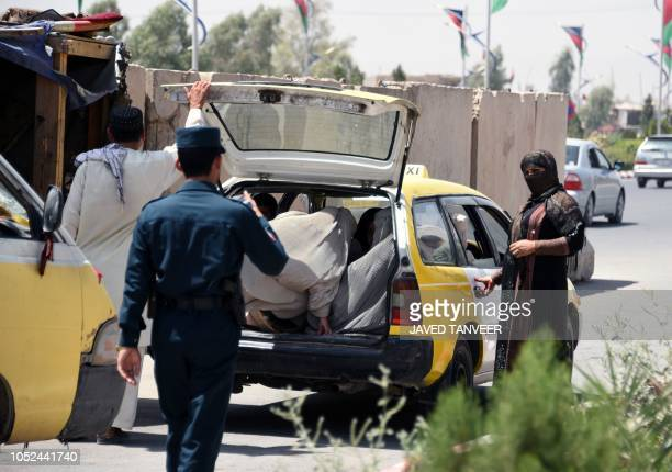 Afghan policemen search passengers at a checkpoint ahead of parliamentary elections in Kandahar on October 18 2018 Doctors Mullahs sons of warlords...