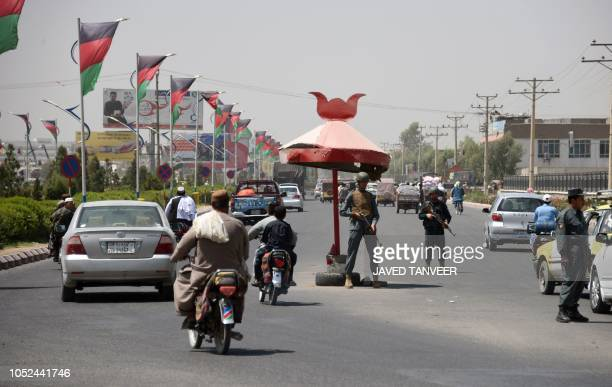 Afghan policemen stand guard at a checkpoint ahead of parliamentary election in Kandahar on October 18 2018 Doctors Mullahs sons of warlords...