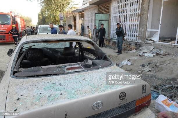 Afghan policemen stand guard at the site of a suicide bomb attack near a Shiite mosque in Kabul on September 29 2017 Up to six people were killed...