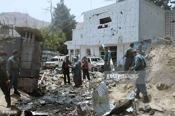 Afghan policemen walk at the site of a suicide attack in front of The Indian Embassy in Kabul on July 7 2008 At least two Indian paramilitary...