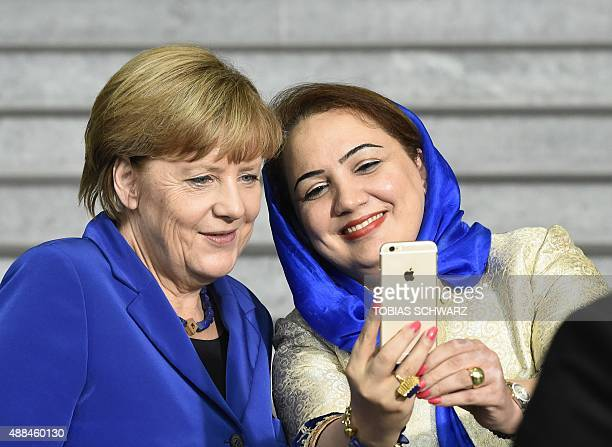 Afghan politician Shukria Barakzai takes a selfie photograph together with German Chancellor Angela Merkel after a socalled G7 women dialog forum at...