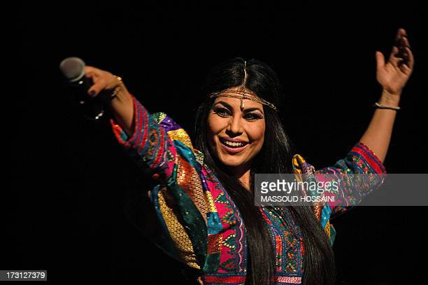 Afghan pop singer Aryana Sayeed performs during a charity concert at the French Culture center in Kabul on July 7 2013 Fundamentalists in Afghanistan...