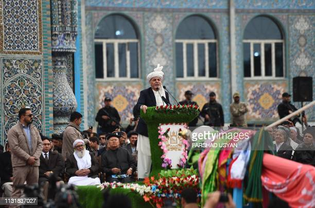 Afghan precedent Ashraf Ghani speaks as other gather near the Hazrat-e-Ali shrine for Nowruz festivities, which marks the Afghan new year, in...
