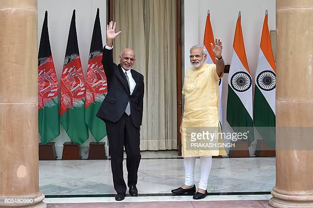 Afghan President, Asharf Ghani and Indian Prime Minister Narendra Modi wave during a photo call prior to a meeting in New Delhi on September 14,...
