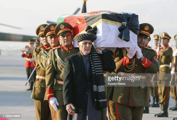 Afghan President Ashraf and soldiers carry the coffin of slain Japanese physician Tetsu Nakamura at a ceremony in Kabul on Dec. 7 before transporting...
