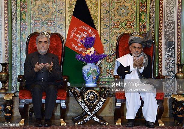 Afghan President Ashraf Ghani and Chief Executive Officer Abdullah Abdullah pray during a visit to Nangarhar province to meet and express sympathy to...