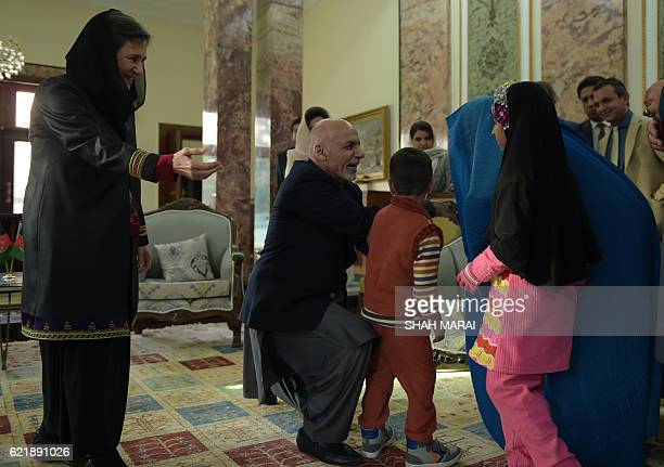 Afghan President Ashraf Ghani and First Lady Rula Ghani welcome Afghan refugee Sharbat Gula at the Presidential Palace on November 9 2016 An Afghan...