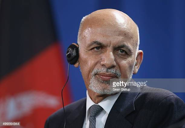 Afghan President Ashraf Ghani and German Chancellor Angela Merkel speak to the media following talks at the Chancellery on December 2 2015 in Berlin...