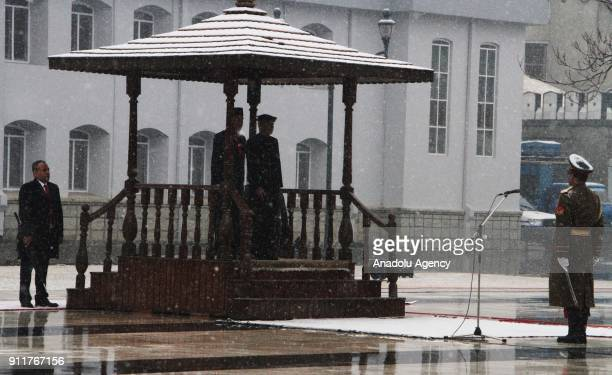 Afghan President Ashraf Ghani and Joko Widodo President of Indonesia arrive to hold a press conference at presidential palace in Kabul Afghanistan on...
