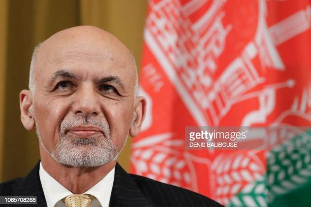 Afghan President Ashraf Ghani attends a UN debate on performance of his country's private sector during the Geneva Conference on Afghanistan on...