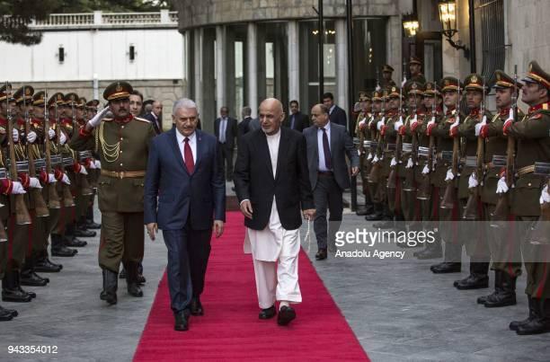 Afghan President Ashraf Ghani bids farewell to Turkish Prime Minister Binali Yildirim in Kabul Afghanistan on April 08 2018