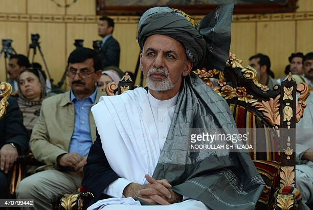 Afghan President Ashraf Ghani looks on during a visit to Nangarhar province to meet and express sympathy to the families of the victims of the recent...