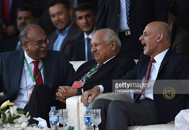 Afghan President Ashraf Ghani shares a light moment with Pakistan Cricket Board Chairman Shahryar Khan and President in waiting of the International...