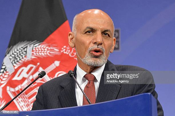 Afghan President Ashraf Ghani speaks during a press conference following a NATO foreign ministers meeting with the Secretary General of NATO Jens...
