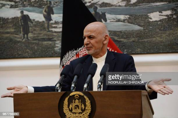 Afghan president Ashraf Ghani speaks during a press conference at the Presidential Palace in Kabul on June 30 2018 Afghan security forces resumed...