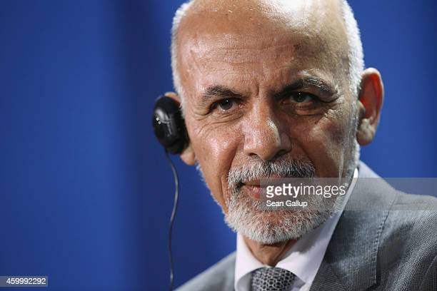 Afghan President Ashraf Ghani speaks to the media with German Chancellor Angela Merkel following talks at the Chancellery on December 5 2014 in...