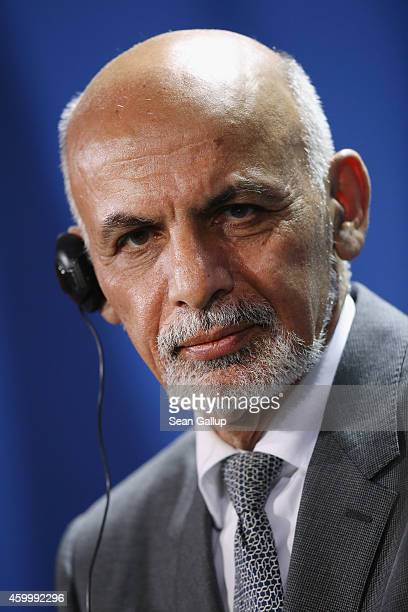 Afghan President Ashraf Ghani speaks to the media with German Chancellor Angela Merkel following talks at the Chancellery on December 5, 2014 in...