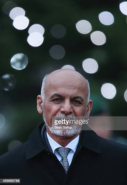 Afghan President Ashraf Ghani walks past a Chrismtas tree upon his arrival at the Chancellery to meet with German Chancellor Angela Merkel on...