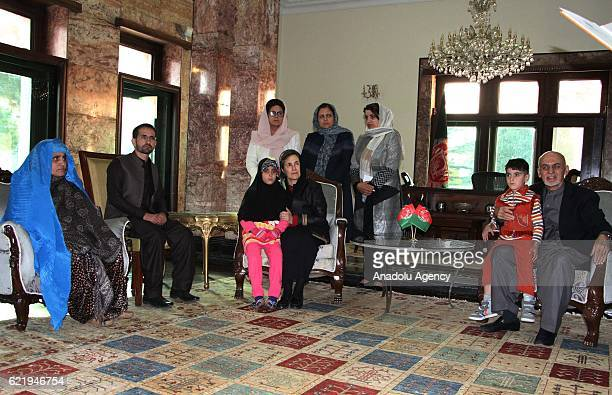 Afghan president Ashraf Ghani welcomes Sharbat Gula and her children at presidential palace in Kabul Afghanistan on November 9 2016 Pakistan has...
