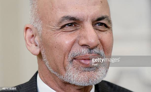 Afghan President Ghani looks on during a restricted bilateral meeting with U.S. President Barack Obama in the Oval Office of the White House March...