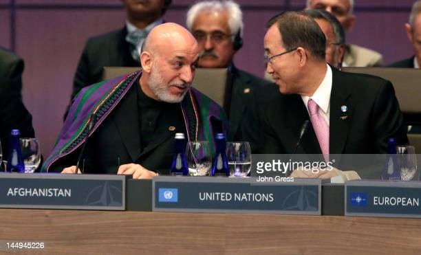 Afghan President Hamid Karzai and UN Secretary General Ban Ki-moon speak during a meeting at the NATO summit on May 21, 2012 at McCormick Place in...