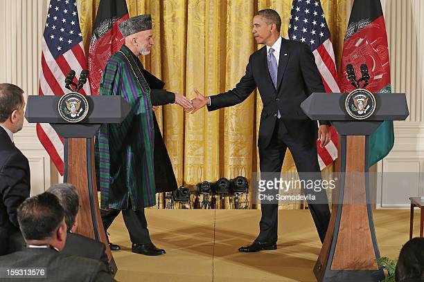 Afghan President Hamid Karzai and U.S. President Barack Obama shake hands after holding a joint news conference in the East Room of the White House...