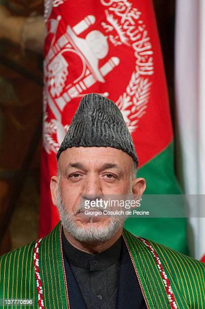 Afghan President Hamid Karzai attends a meeting with Italian Prime Minister to sign a bilateral agreement on cooperation and partnership, at Palazzo...