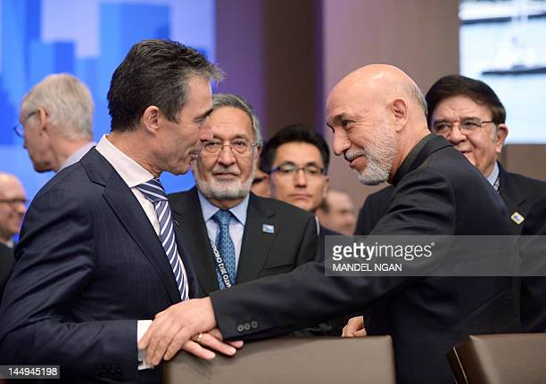 Afghan President Hamid Karzai chats with NATO Secretary General Anders Fogh Rasmussen as Afghan Foreign Minister Zalmai Rasoul and Afghan Defense...