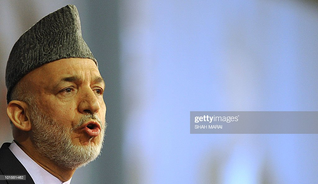 Afghan President Hamid Karzai delivers a speech to the National Consultive Peace Jirga in Kabul on June 2, 2010. The Taliban claimed responsibility for a series of attacks on a landmark gathering in the Afghan capital, where hundreds of delegates are meeting to discuss peace talks. 'We have four suicide attackers placed on the top of a tall building near the jirga tent. They are threatening the jirga tent,' Zabihullah Mujahid, a Taliban spokesman, told AFP by telephone.AFP PHOTO/SHAH Marai