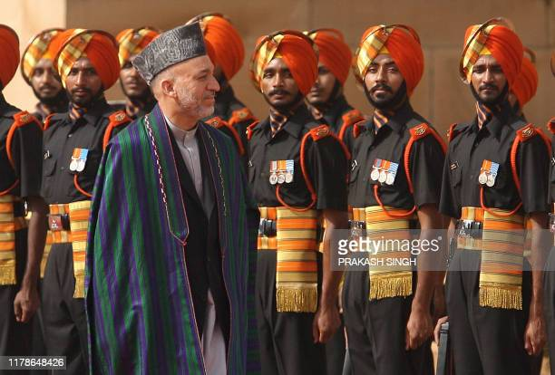 Afghan President Hamid Karzai inspects a guard of honour during a ceremonial reception at Presidential Palace in New Delhi, 10 April 2006. Karzai,...