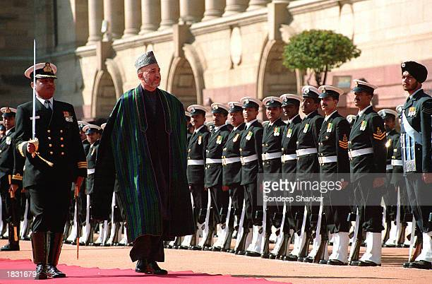 Afghan President Hamid Karzai inspects an honor guard from a military contingent during a ceremonial reception at the Presidential Palace March 6...