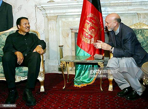 Afghan President Hamid Karzai meets Muhammad Ali former international boxing champion in Kabul 17 November 2002. Muhammad Ali is on a visit as a UN...
