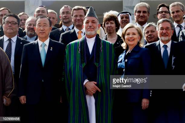 Afghan President Hamid Karzai poses with United Nations Secretary General Ban Kimoon to his right and US Secretary of State Hillary Clinton to his...