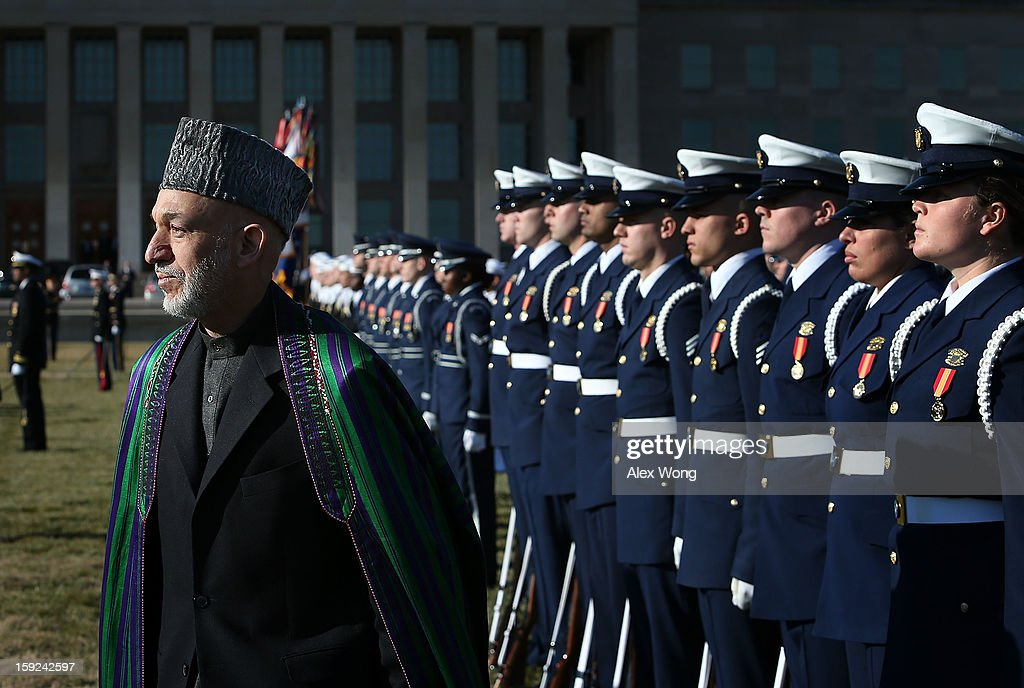 Afghan President Hamid Karzai (L) reviews the honor guards during a full military honors ceremony welcoming Karzai to the Pentagon January 10, 2013 in Arlington, Virginia. Karzai is on a visit in Washington, to include a meeting with U.S. President Barack Obama at the White House, to discuss the continued transition in Afghanistan and the partnership between the two nations.