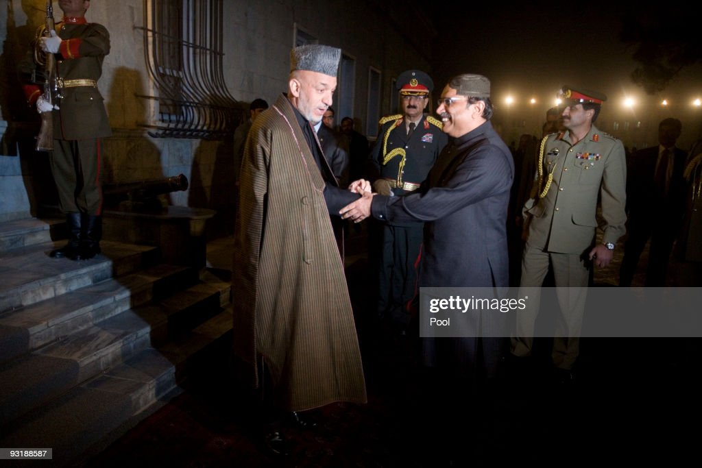 Afghan President Hamid Karzai (L) shakes hands with Pakistan President Asif Ali Zardari at the presidential palace on November 18, 2009 in Kabul, Afghanistan. Zardari arrived in Afghanistan to attend Thursday's inauguration of Afghan President Hamid Karzai. (Musadeq Sadeq-Pool/Getty Images))