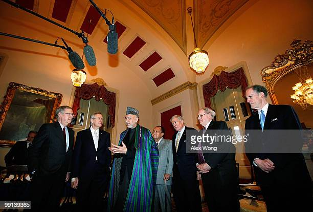Afghan President Hamid Karzai speaks as US Senate Minority Leader Sen Mitch McConnell Senate Majority Leader Sen Harry Reid Sen Daniel Inouye Sen...
