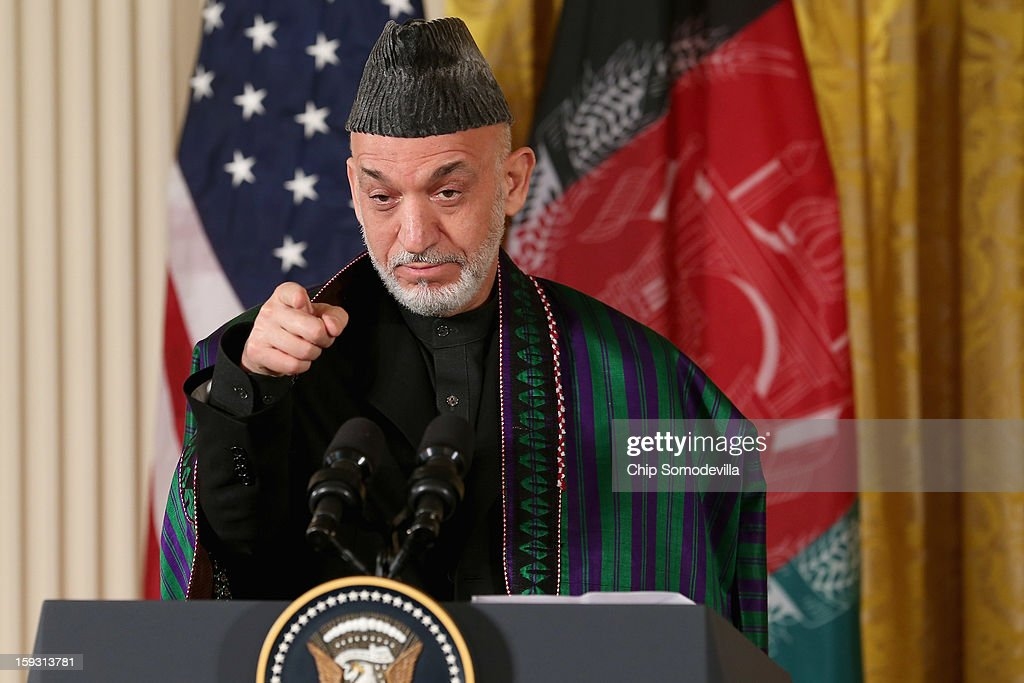 Afghan President Hamid Karzai speaks during a joint news conference with U.S. President Barack Obama in the East Room of the White House January 11, 2013 in Washington, DC. Karzai is in Washington for face-to-face meetings with Obama and senior members of his administration about the future of American commitment to Afghanistan and when troops may leave the country after more than 10 years of war.
