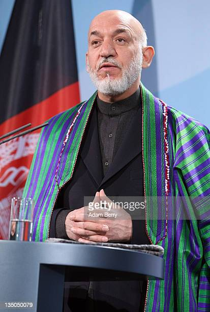 Afghan president Hamid Karzai speaks during a news conference in the German federal chancellery on December 6, 2011 in Berlin, Germany. Karzai met...