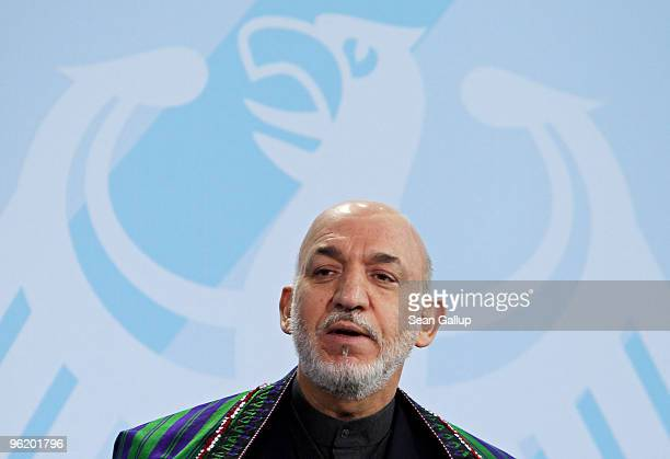 Afghan President Hamid Karzai speaks to the media after talks with German Chancellor Angela Merkel at the Chancellery on January 27, 2010 in Berlin,...