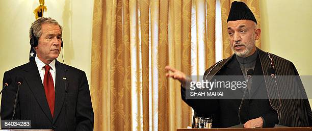 Afghan President Hamid Karzai talks as US President George W. Bush listens during a joint press conference at the Presidential Palace in Kabul on...