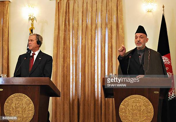 Afghan President Hamid Karzai talks as US President George W. Bush looks on during a joint press conference at the Presidential palace in Kabul on...