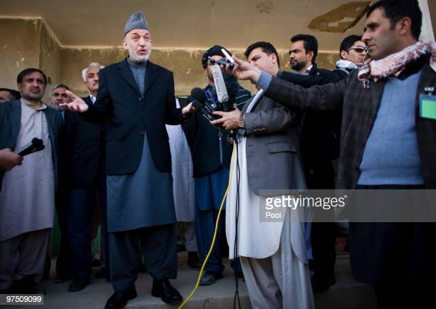 Afghan President Hamid Karzai talks to media after meeting with local elders March 7, 2010 in the southern province of Helmand of Marjah,...
