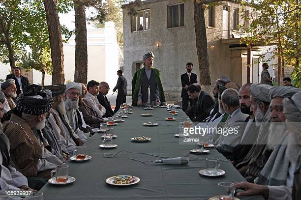 Afghan President Karzai meets with elders and tribal leaders from the Kunar province in September 2004 at the Presidential Palace in Kabul Afghanistan