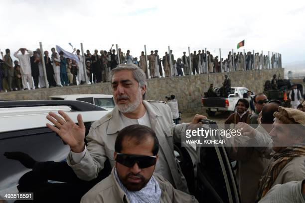 Afghan presidential candidate Abdullah Abdullah gestures as he leaves after attending a campaign rally in Gardez capital of eastern Paktia province...