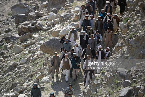 Afghan presidential candidate Abdullah Abdullah visits a camp for flood victims in the Guzirga iNur district of Baghlan province on June 8 2014...
