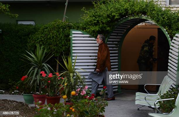 Afghan presidential candidate Abdullah Abdullah walks before an interview with media at his residence in Kabul on April 24 2014 Former foreign...