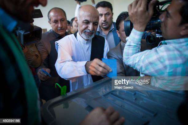 Afghan presidential candidate Ashraf Ghani casts his vote at a polling station on June 14 2014 in in Kabul Afghanistan Polling stations have opened...