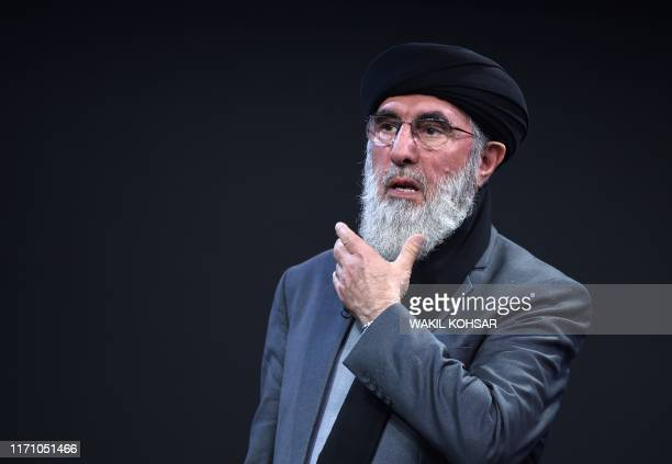 Afghan presidential candidate Gulbuddin Hekmatyar delivers a speech during a presidential debate at Tolo News TV station in Kabul on September 25...