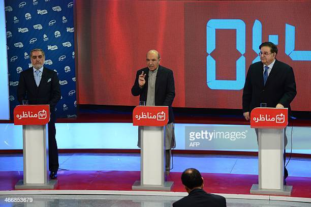 Afghan presidential candidates left to right Abdullah Abdullah Qayum Karzai and Abdul Rahim Wardak take part in a debate at Tolo TV station in Kabul...